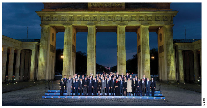 The ministers and heads of delegation in front of the Brandenburg Gate during NATO's April meeting in Berlin.