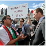 At an event marking the return of HMCS Charlottetown to the port of Halifax after a six-month deployment to the Mediterranean Sea, the Maritime Libya Association's Fathi Ghanai tells Defence Minister Peter MacKay about the thanks he's receiving from Libyans for Canada's contributions in their country.