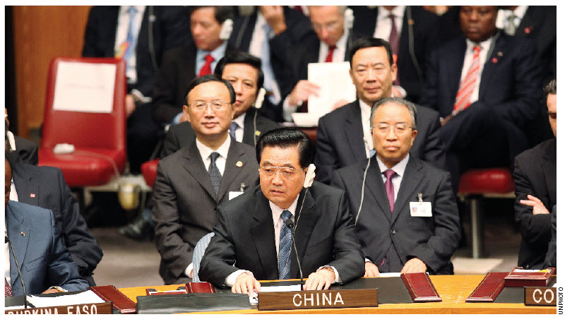 Chinese Ambassador Zhang Junsai argues that although China has, over the past 62 years, lifted more than 200 million Chinese out of poverty, the country, run by President Hu Jintao, above, is still considered a developing nation.