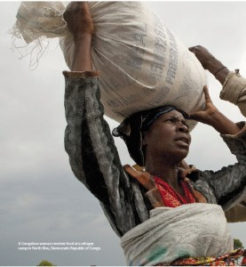 A Congolese woman receives food at a refugee camp in North Kivu, Democratic Republic of Congo.