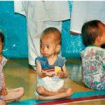 Nursery school children in a village northwest of Pyongyang, North Korea, receive rations of food.