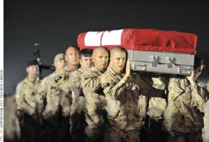 Soldiers take part in a ramp ceremony at Kandahar Airfield for Master Corporal Francis Roy, who died in Kandahar City in June 2011.