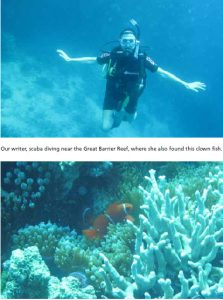 Our writer, scuba diving near the Great Barrier Reef, where she also found this clown fish.