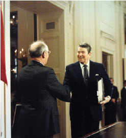 U.S. President Ronald Reagan greets Soviet Union President Mikhail Gorbachev