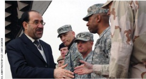 Iraqi Prime Minister Nouri al-Maliki greets U.S. soldiers during Iraqi Army Day.