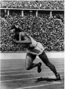 American track athlete Jesse Owens at the start of record-breaking 200-metre race during the Olympic games 1936 in Berlin.