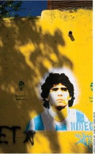 Diego Maradona, above in street graffiti and below during the World Cup final, scored a truly divine — and winning — goal in the semi-final match between Argentina and England. His team went on to beat Germany in the final.