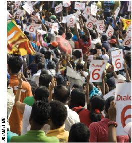Fans in Colombo, Sri Lanka cheer their team at the Cricket World Cup 2011 final against India. India won.