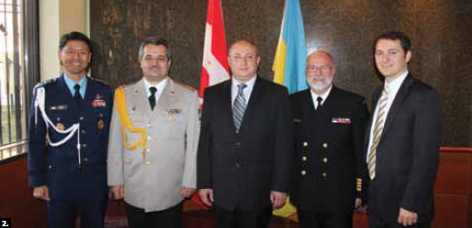 2. The embassy of Ukraine held a reception to mark Armed Forces Day. From left, Korean defence attaché Col. Soo Wan Lee, Ukrainian defence attaché Col. Ihor Likarenko, Ukraine chargé d'affaires Mykhailo Khomenko, National Defence director Capt. S.C.Bertrand and Ukraine's second secretary Denys Sienik.