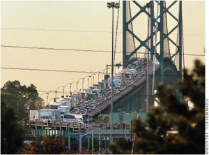 The Ambassador Bridge between Detroit and Windsor is heavily trafficked. The new Detroit River International Crossing project would add a second bridge to the region.