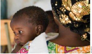 A mother and child in Kigali's Village of Hope. The Rwandan Women Network in Kigali shelters genocide widows and their families and offers medical and educational services and business training.
