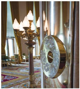 Two sets of magnificent bronze doors to the grand salon feature engraved door pulls. The medallions are delicately engraved with four major themes: labour, family, faith and remembrance.