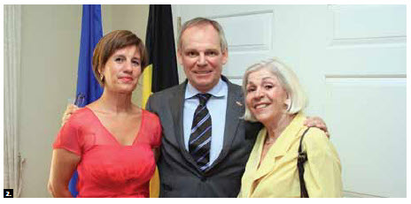 2. In July, Belgian Ambassador Bruno van der Pluijm and his wife, Hildegarde, hosted a national day reception at their residence. At right, chief of protocol Margaret Huber. (Photo: Sam Garcia)