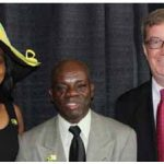 A flag-raising for Jamaica's 50th anniversary of independence took place at City Hall in August. From left, Jamaican High Commissioner Sheila Sealy-Monteith, Elisha Campbell, president of the Jamaica-Ottawa Community Association, and Mayor Jim Watson. (Photo: Joan Wright)