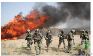 DEA officers and American soldiers take part in a hashish-burning operation in Afghanistan.