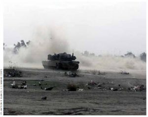 A Marine Corps battle tank fires in Iraq during the U.S. invasion in 2003.
