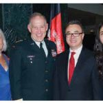 At right, Afghan Ambassador Barna Karimi and his wife, Storai, hosted a national day reception. Former chief of defence staff Walter Natynczyk and his wife, Leslie (at left) attended. (Photo: Bruce MacRae)