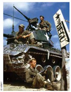 The crew of an M-24 tank along the Naktong River front in Korea.