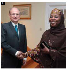 Portuguese Ambassador Jose Fernando Moreira da Cunha hosted a reception at his residence to mark Portugal's National Day. He's shown greeting Mali Ambassador Ami Diallo Traore. (Photo: Sam Garcia)