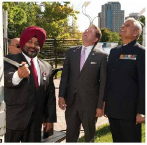 Deputy Mayor Steve Desroches and Indian High Commissioner Nirmal Verma watch as Jagdeep Perhar, president of the India Canada Association, raised India's flag at Ottawa City Hall to mark the 66th anniversary of India's Independence.