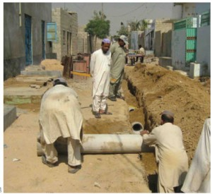 Orangi Pilot Project volunteers help build a lane sewer in Gulshan-e-Zia, Karachi, Pakistan.