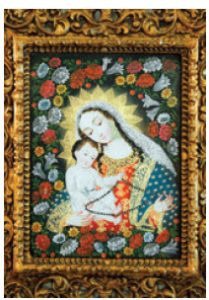 Madonna and Child are dressed in traditional Peruvian clothing.