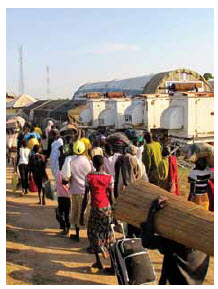 Civilians fleeing the fighting seek refuge at a UN compound in Bor.