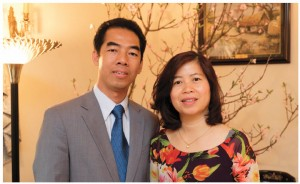 Ambassador To, with his wife, Tran Phi Nga, who wears an Ao Dai, a hand-painted silk dress traditional in Vietnam.