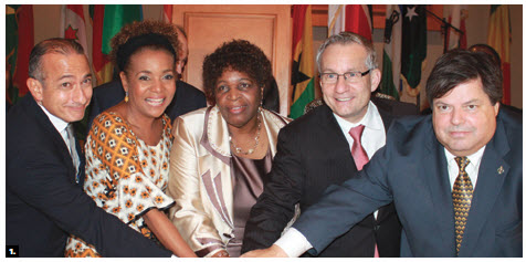 Africa Day took place at St. Elias Centre. From left, outgoing Egyptian Ambassador Wael Aboulmagd, former governor general Michaëlle Jean, Zimbabwean Ambassador Florence Chideya, Trade Minister Ed Fast, and Liberal MP Mauril Bélanger cut the cake. (Photo: Ulle Baum)