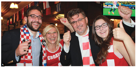 To mark Croatia's National Day and the World Cup Inaugural Match between Croatia and Brazil, Ambassador Veselko Grubisic and his family celebrated at the Earl of Sussex Pub. From left, Matthew, Martha, Veselko and Ana Maria Grubisic. (Photo: Ulle Baum)