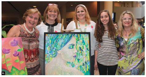 Silvia Bompadre, second from left and wife of Argentina's minister, presented an art show of her work and the work of her students. From left, Bibiana Piza, wife of the Costa Rican ambassador, Ms Bompadre, Lidia Nunez, wife of the ambassador of Paraguay, Maria Leonor Sabido Costa (Portugal), and Silvia Genereux. (Photo: Ulle Baum)