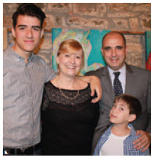 Silvia Bompadre, wife of the Argentine embassy's minister, participated in an art exhibition at St. Brigid's Centre for the Arts. She is shown with her husband, and two sons, Nicolas (left) and Santiago (front). (Photo: Ulle Baum)