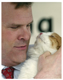 With his beloved late cat, Thatcher.