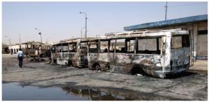 A bus parked near a terminal in central Baghdad, Iraq, was destroyed by two car bombs in a 2005 attack orchestrated by Sunnis stepping up their insurgency in protest of the Shi'ite government.
