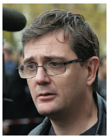 Charlie Hebdo editor Stéphane Charbonnier, wasn't a stranger to terrorism. Here, he answers questions after a firebombing of Charlie Hebdo offices in 2011.