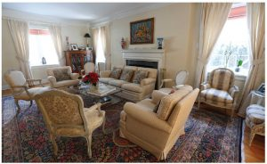 The home features plenty of space for entertaining, including this main drawing room, which features an antique Kerman rug, a reminder of Mrs. Delcorde's Iranian heritage.