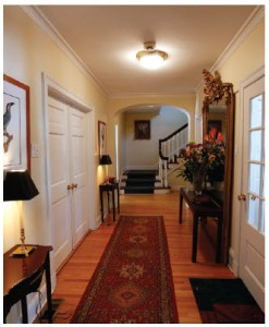 The home's front hall has grand features, including a floor-to-ceiling antique gold mirror.