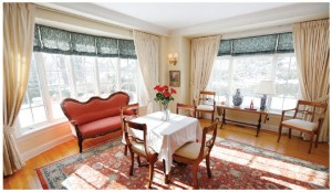 A dining room addition has created a bright and sunny room — cozy regardless of season — with views over the expansive gardens.