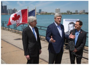 From left, Michigan Governor Rick Snyder, Prime Minister Stephen Harper and Murray Howe, Gordie Howe's son, announced in May that the Detroit River International Crossing will be named the Gordie Howe International Bridge. (Photo: PMO)