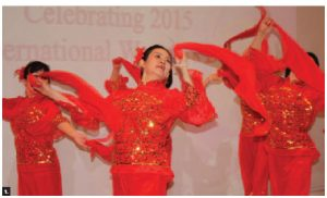 The embassy of China hosted an International Women's Day celebration. The event included cultural performances presented by female diplomats from China, invited musicians, singers and dancers. Jiang Yili, wife of the Chinese ambassador, front, leads a dance performed by the female diplomats of the Chinese embassy. (Photo: Ulle Baum)