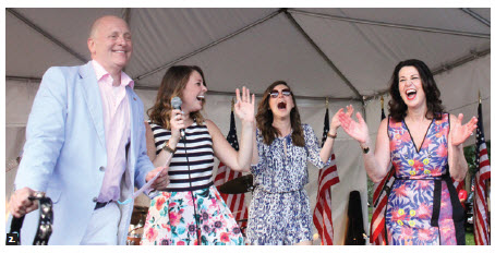 U.S. Ambassador Heyman, left, and his wife, Vicki, right, hosted a 4th of July party at Lornado, the name of the ambassador's residence. With their daughters Caroline, left, and Liza, they joined the band on stage. (Photo: Ulle Baum)