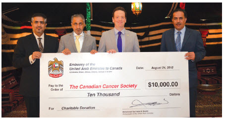 At the cheque presentation, from left, Hamad Al Awadi, counsellor at the embassy; Ambassador Mohammed Saif Helal Al Shehhi; Gabriel Miller, director of public issues for the Canadian Cancer Society; and Jamal Al Zaabi, attaché.