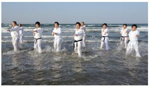 Karate training at the beach in Ehime, Japan.