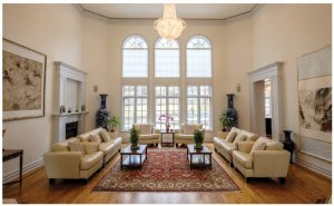 The grand reception room features simple furniture and huge windows that show off the fine art. (Photo: Dyanne Wilson)