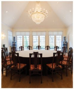The dining room features a round table with 16 chairs. It can easily be converted to a banquet hall for sizable buffet dinners. (Photo: Dyanne Wilson)