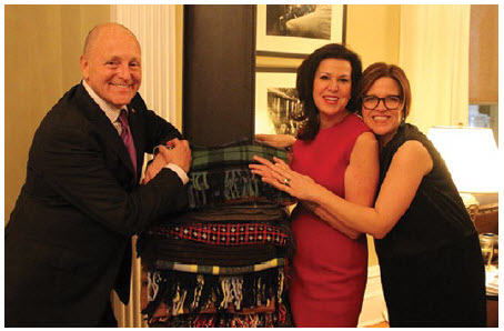 Artist Marie Watt, right, and Bruce and Vicki Heyman stand with Watt's blanket sculpture, which has spent the year at the ambassador's residence as part of Art in Embassies. (Photo: Embassy of the United States)