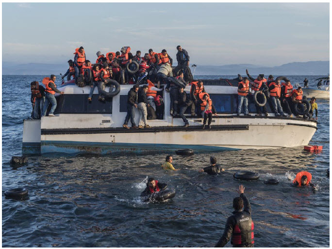 Syrian refugees arrive on the Greek island of Lesbos after crossing the Aegean Sea from Turkey. (Photo: © UNHCR/Ivor Prickett)