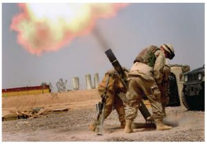 U.S. soldiers fire mortars during Operation Iraqi Freedom. The protracted war resulted in the arrest of Saddam Hussein, who was eventually sentenced to death by hanging. (Photo: U.S. Army)