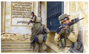 U.S. Marines prepare to enter one of Saddam Hussein's palaces in Bagdad during Operation Iraqi Freedom in 2003. Ambassador Kaab says this invasion brought a fragile democracy to Iraq. (Photo: U.S. Army)