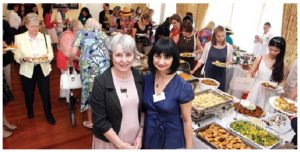 Professor Janine Krieber, wife of Foreign Minister Stéphane Dion, and Maria Yeganian, vice-president of HOMSA and wife of the Armenian ambassador, stand by the buffet lunch, which was donated by diplomatic spouses. (Photo: Sam Garcia)